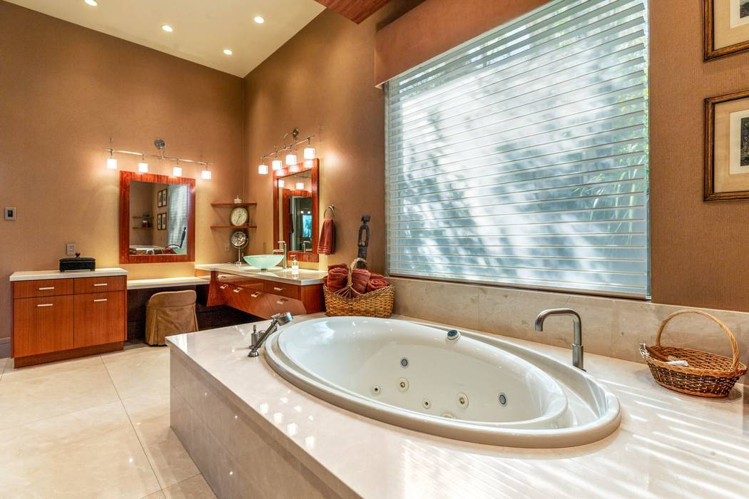 The spa-like master bath features an oval tub, walk-in shower and dual sinks with a makeup stat ...