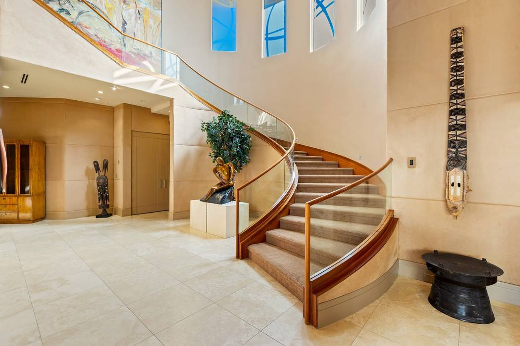 The three-level home has a wide staircase. (Ivan Sher Group)