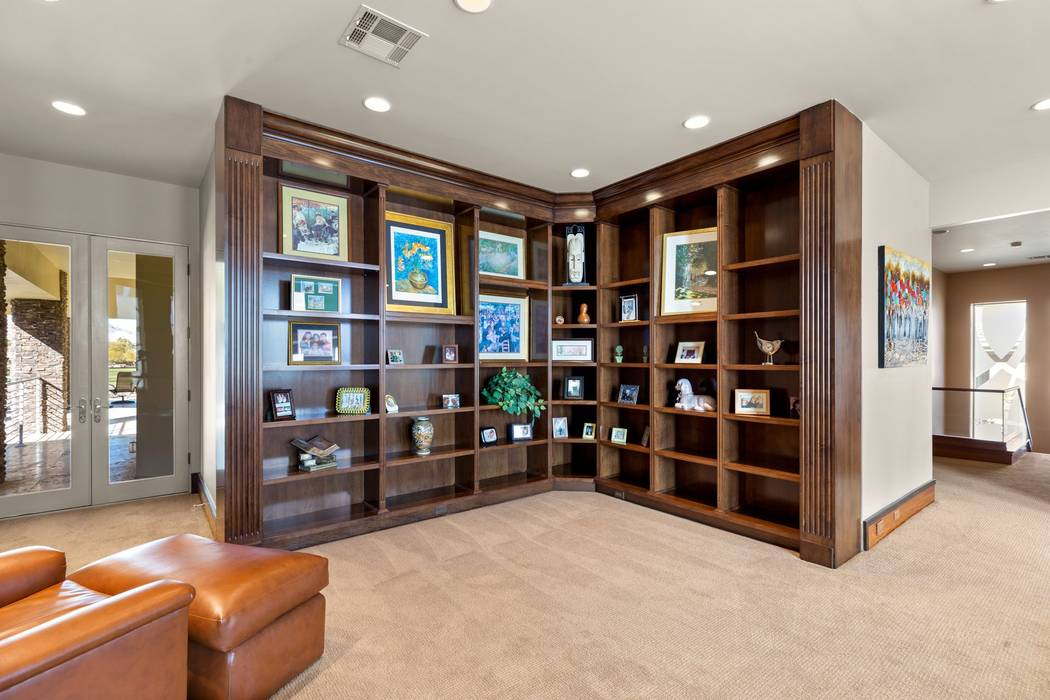 The upstairs master suite has a library. (Ivan Sher Group)