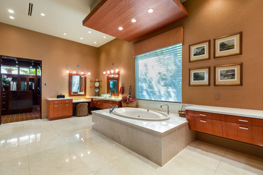 The spa-like master bath features granite counters and flooring. (Ivan Sher Group)