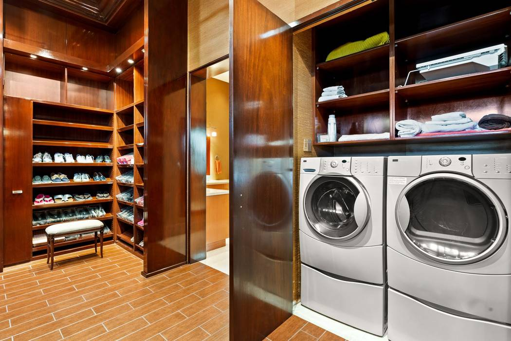 The closet has a laundry area. (Ivan Sher Group)