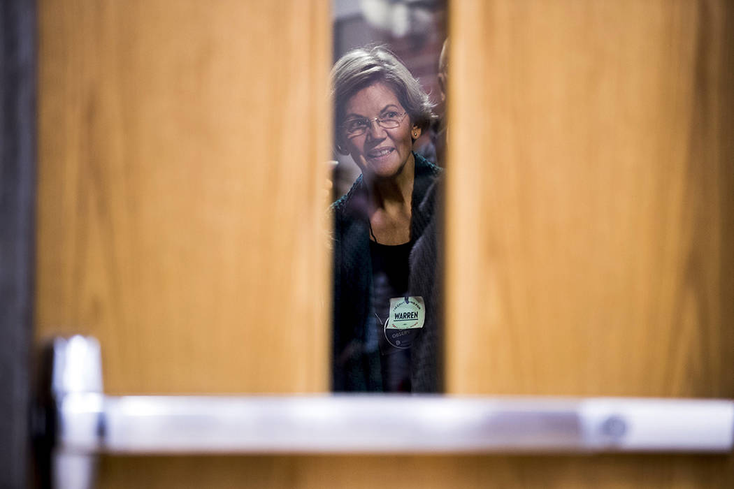 Democratic presidential candidate Sen. Elizabeth Warren, D-Mass., waits to be announced into a ...