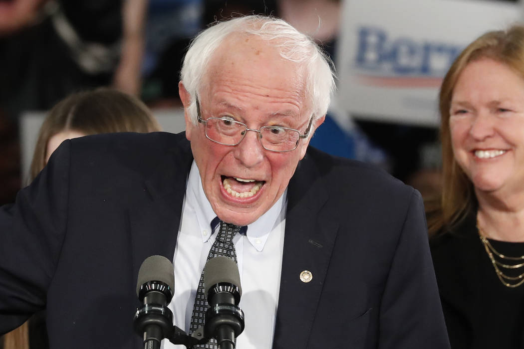 Democratic presidential candidate Sen. Bernie Sanders, I-Vt., speaks to supporters at a caucus ...