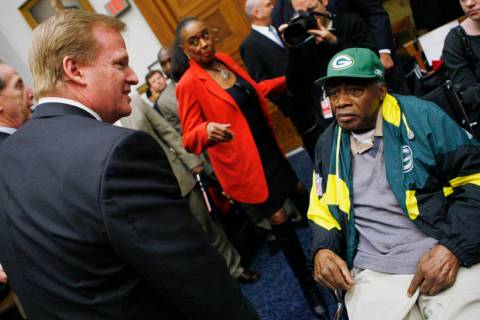 FILE - In thisWednesday, Oct. 28, 2009 file photo, NFL Commissioner Roger Goodell, left, meets ...