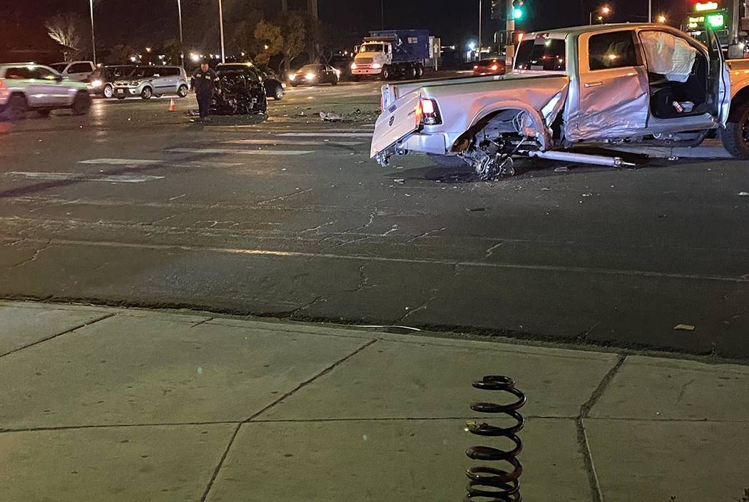 The rear axle of a pickup tuck is missing after a collision at Nellis and Lake Mead boulevards ...