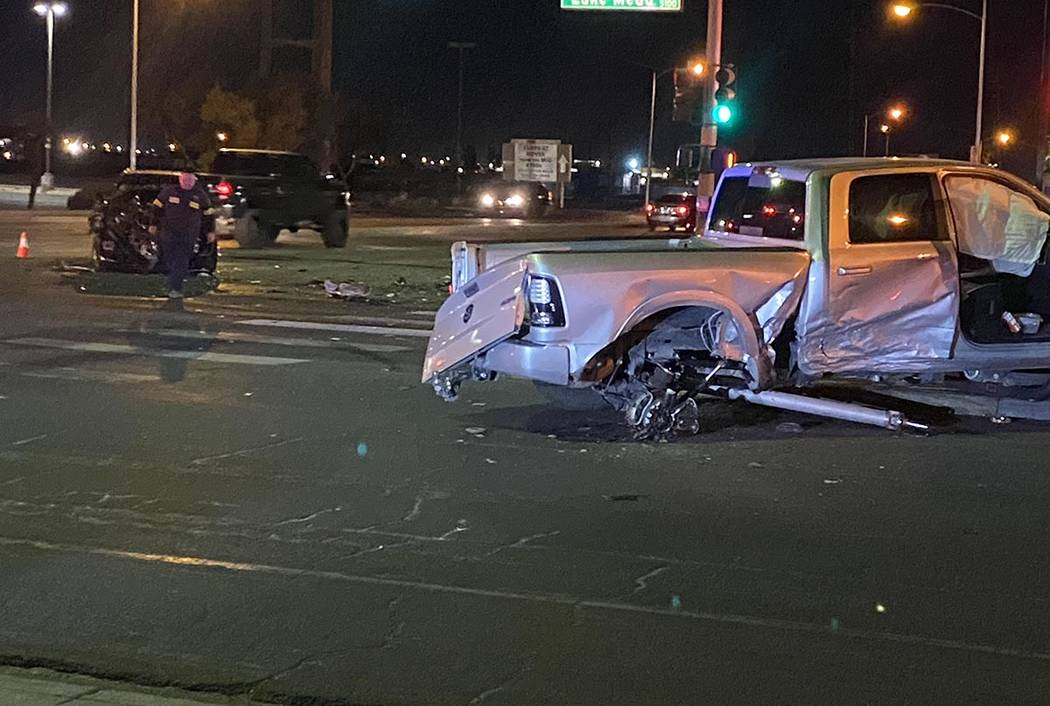 The rear axle of a pickup truck is gone after a collision at Nellis and Lake Mead boulevards on ...
