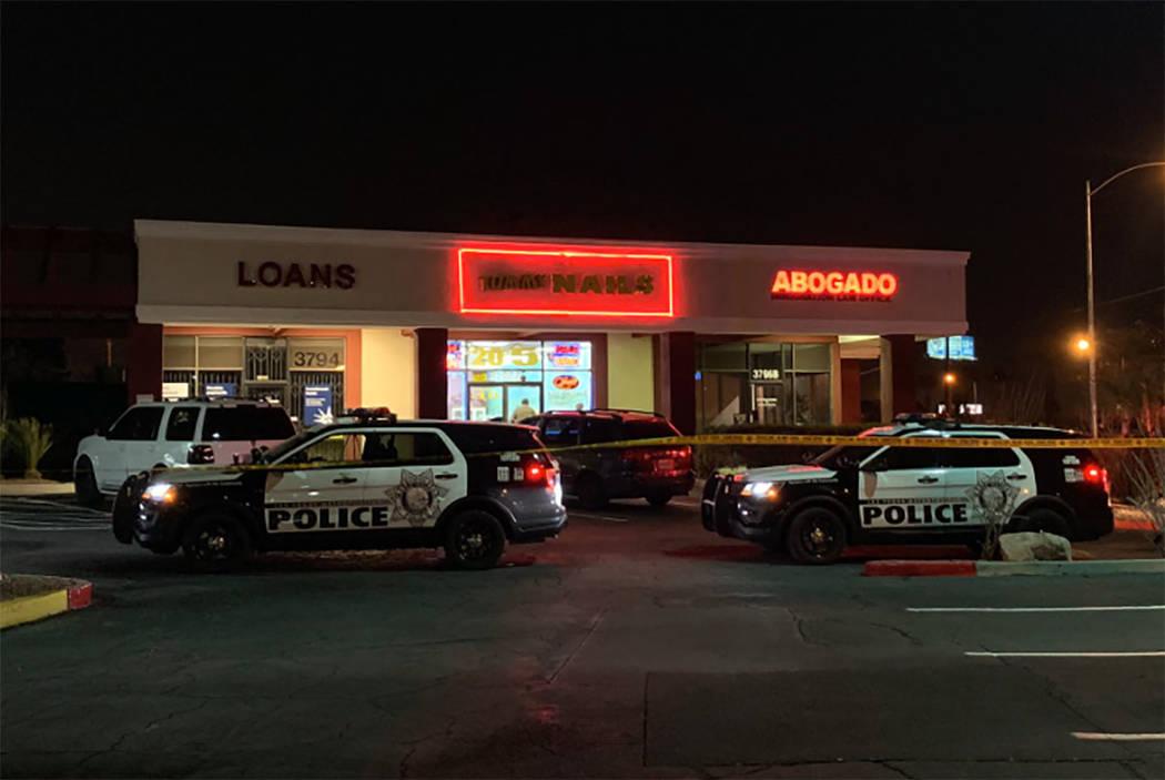 Police investigate the scene of a fatal shooting near Sandhill and Desert Inn roads in Las Vega ...