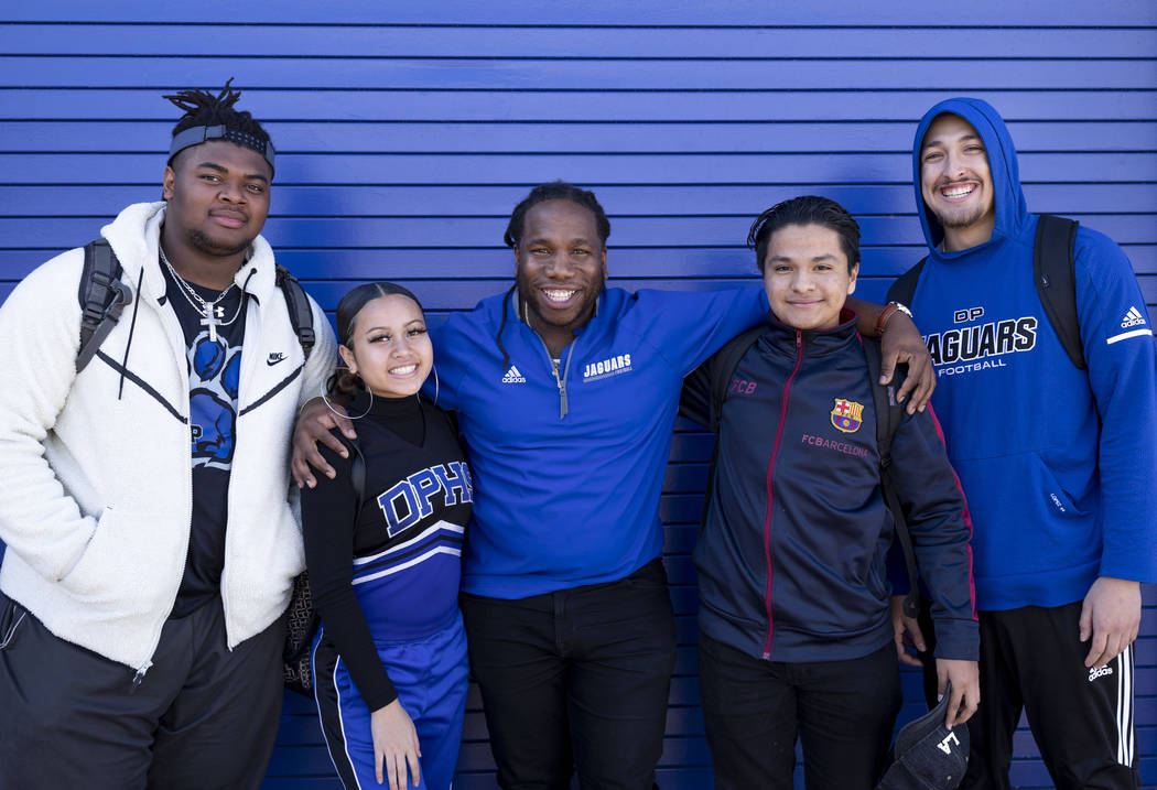 Assistant football coach and Life Skills teacher David Hill, center, with his students from lef ...