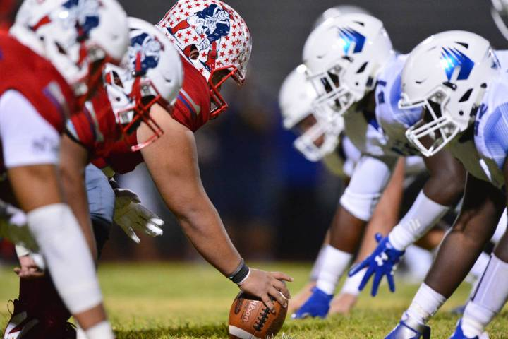 Liberty center Jeremiah Taiese (75) gets ready to snap the ball during a game against IMG Acade ...