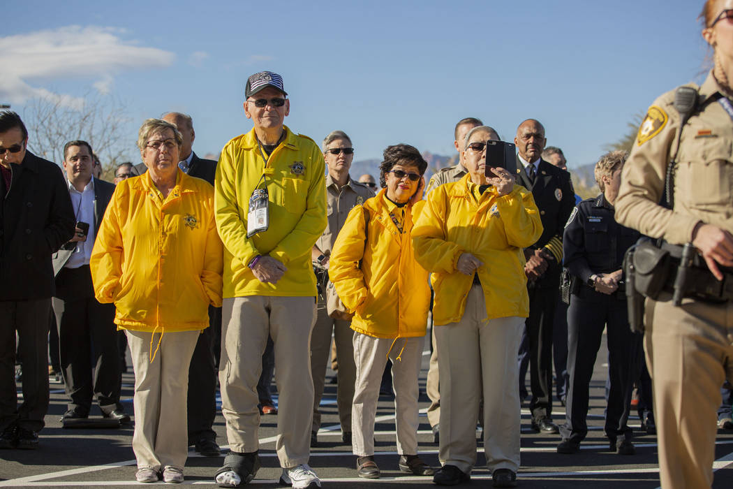 Members of the community and police volunteers listen to Summerlin Area Command Capt. Sasha Lar ...