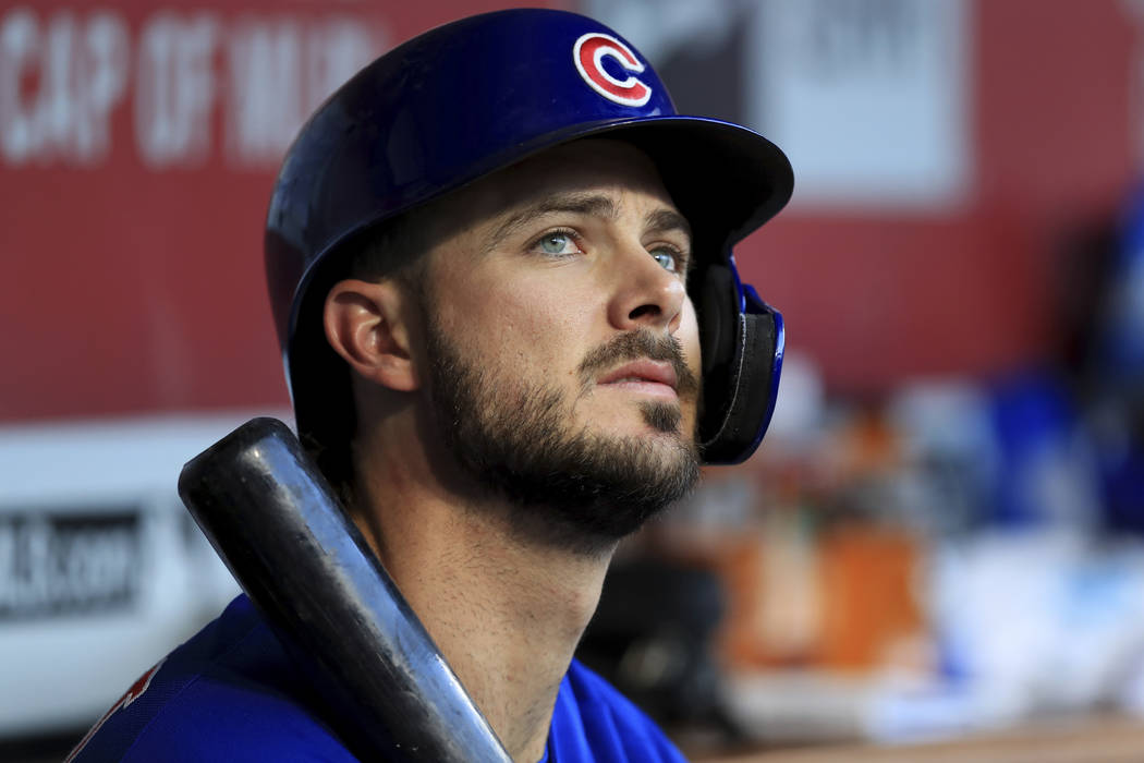 FILE - In this Aug. 10, 2019, file photo, Chicago Cubs' Kris Bryant (17) sits in the dugout dur ...