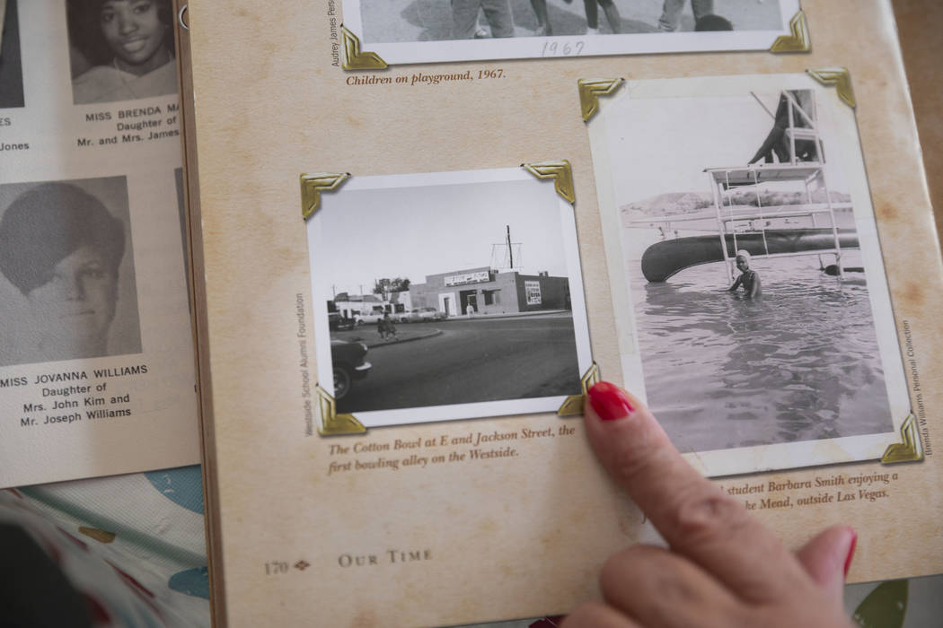 Jackie Brantley, who grew up blocks away from Jackson Street in West Las Vegas, shows a photogr ...