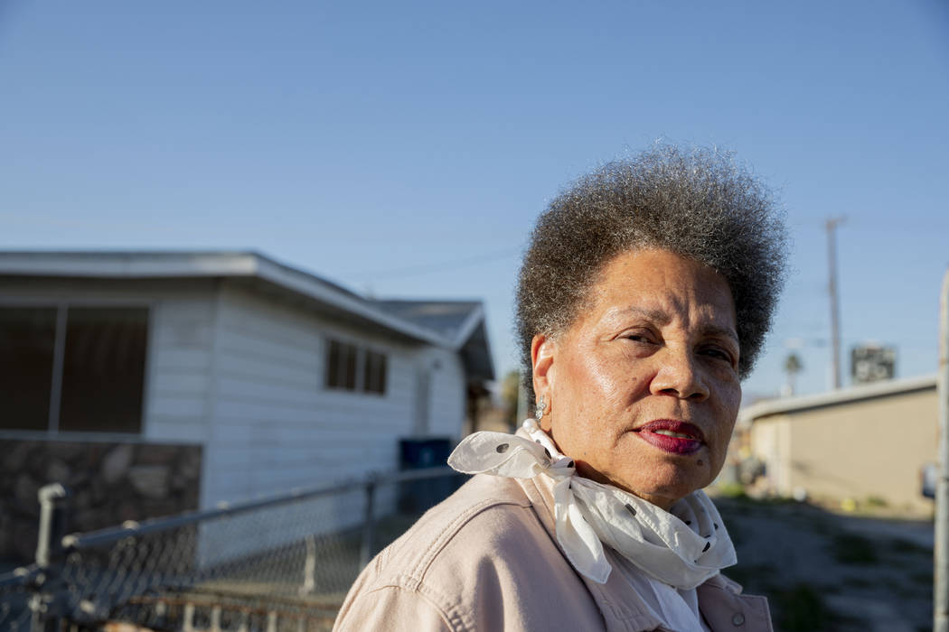 Jackie Brantley stands in front of the home she grew up in located only two blocks away from Ja ...