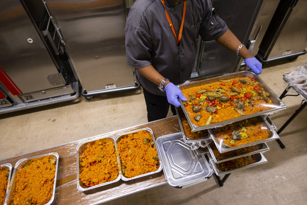 Sarif El-Amin, of Three Square food bank, packages vegan jambalaya and other surplus banquet fo ...