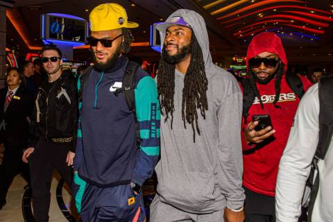 San Francisco 49ers' Fred Warner, from left, Richard Sherman and Jacob Thieneman are shown at T ...