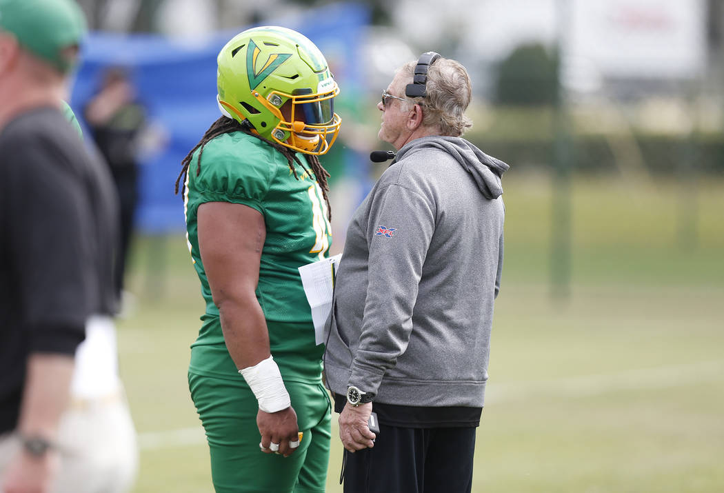 Tampa Bay Vipers defensive tackle Nikita Whitlock (49) talks with defensive coordinator Jerry G ...