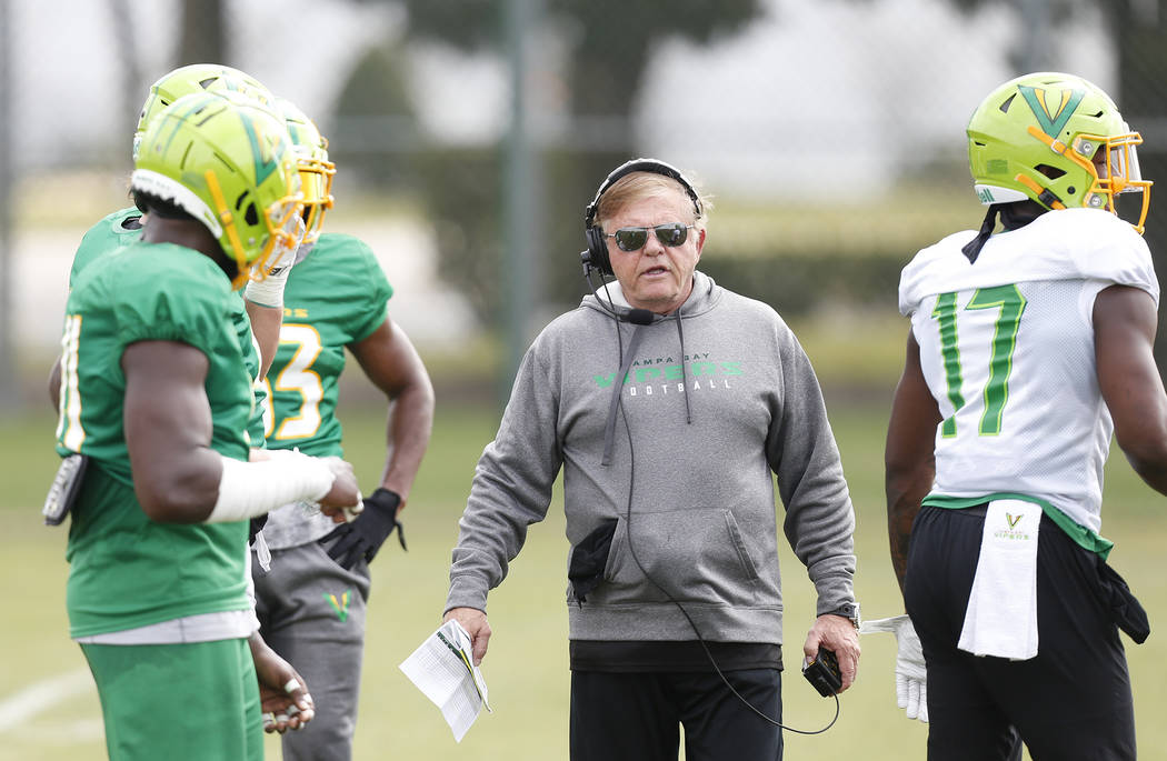 Tampa Bay Vipers defensive coordinator Jerry Glanville talks with his players during practice a ...