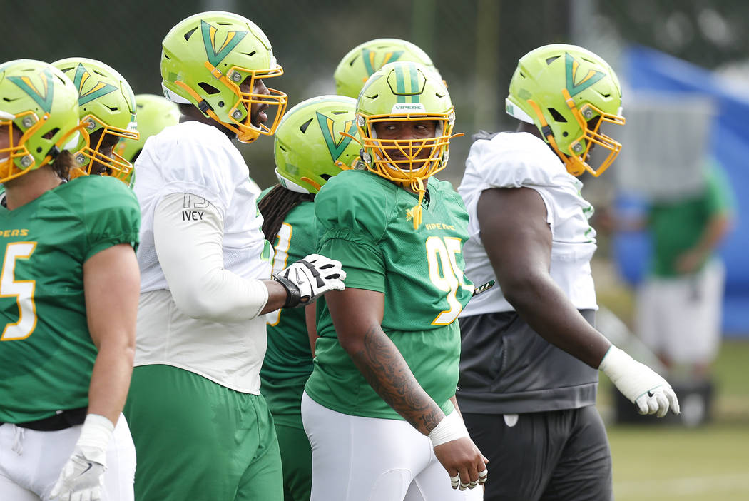 Tampa Bay Vipers Martez Ivey (73), left, and defensive tackle Cece Jefferson (95) runs through ...