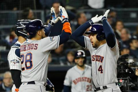 Houston Astros' George Springer, right, celebrates with Robinson Chirinos after his three-run h ...