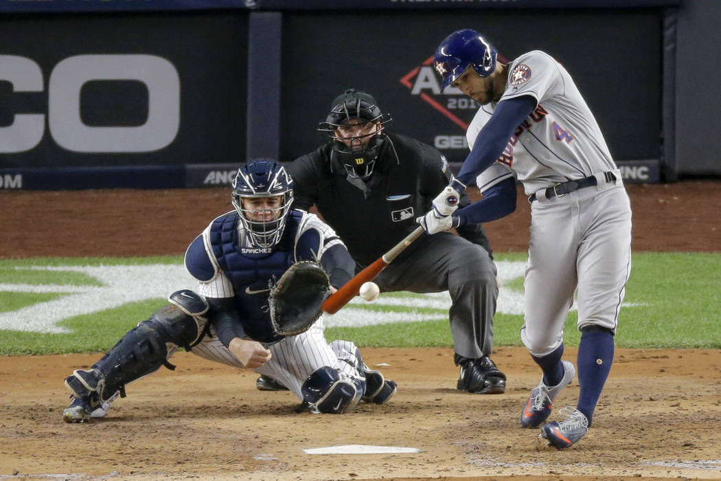 Houston Astros' George Springer (4) connects for a three-run home run against the New York Yank ...