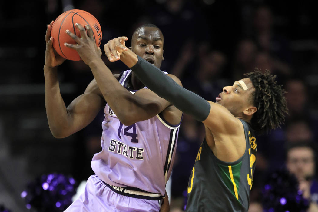 Kansas State forward Makol Mawien (14) and Baylor forward Freddie Gillespie (33) during the fir ...