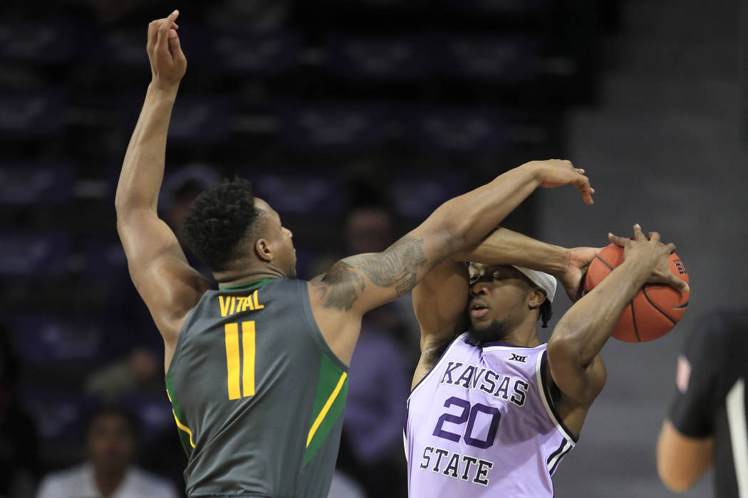 Baylor guard Mark Vital (11) and Kansas State forward Xavier Sneed (20) during the first half o ...