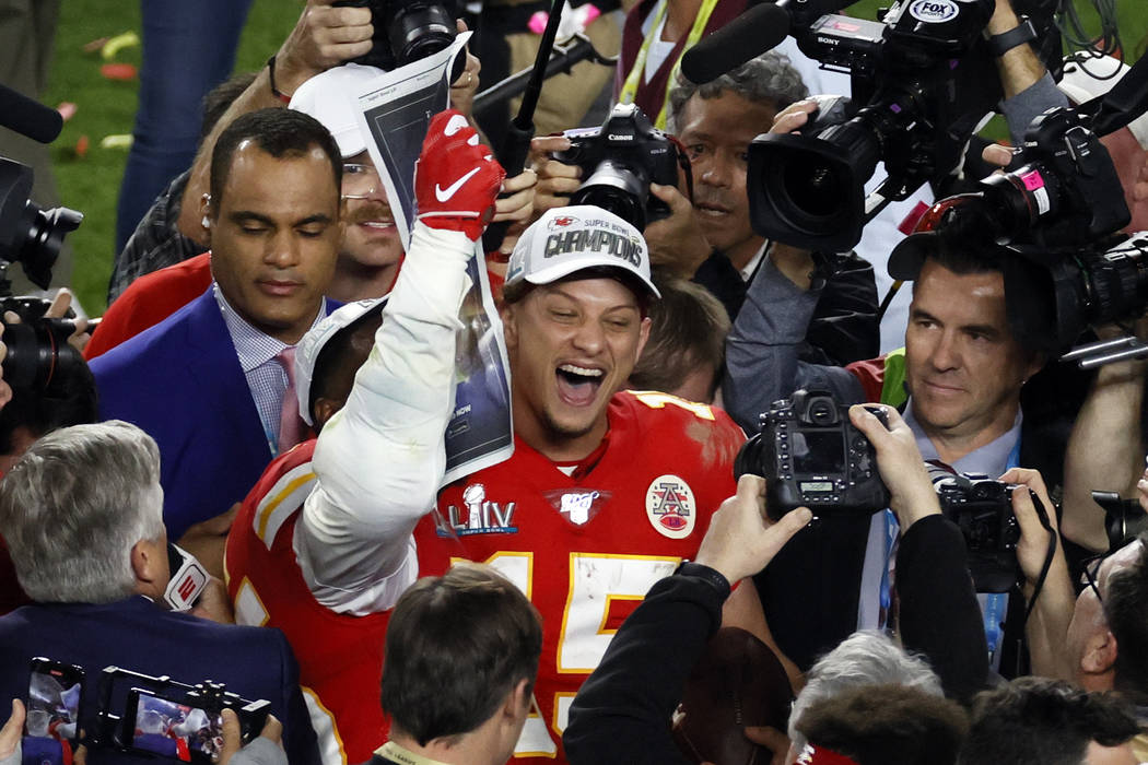 Kansas City Chiefs quarterback Patrick Mahomes (15) celebrates after defeating the San Francisc ...