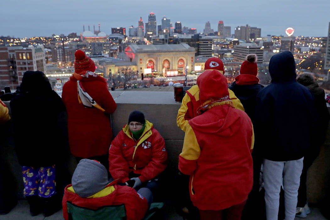People gather at the Liberty Memorial as they wait for a parade through downtown Kansas City, M ...