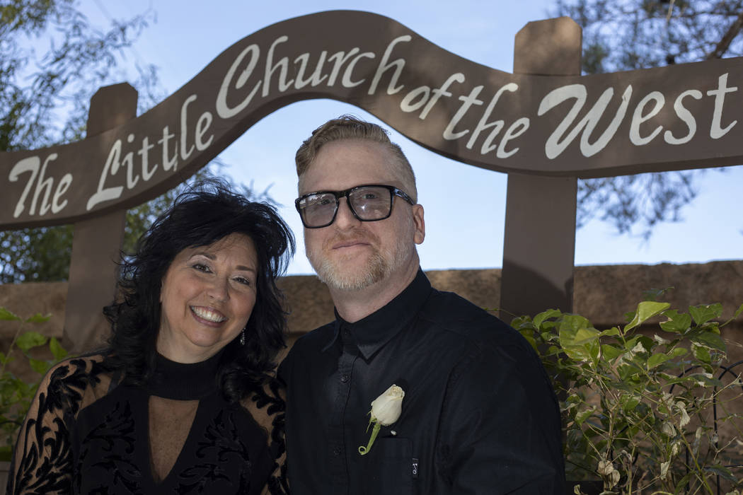 Florida-based couple Patrick McFarland and Melissa Hill pose for a portrait after getting marri ...