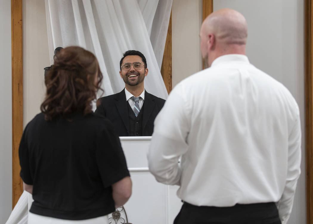 Mike Kelly, middle, owner of The Little Vegas Chapel, officiates over the wedding of Jordan Wil ...