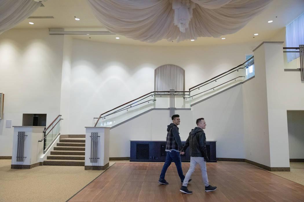 Las Vegas locals Sam Cruz, left, and Jeff Gaglione look at their future wedding venue at Emeral ...