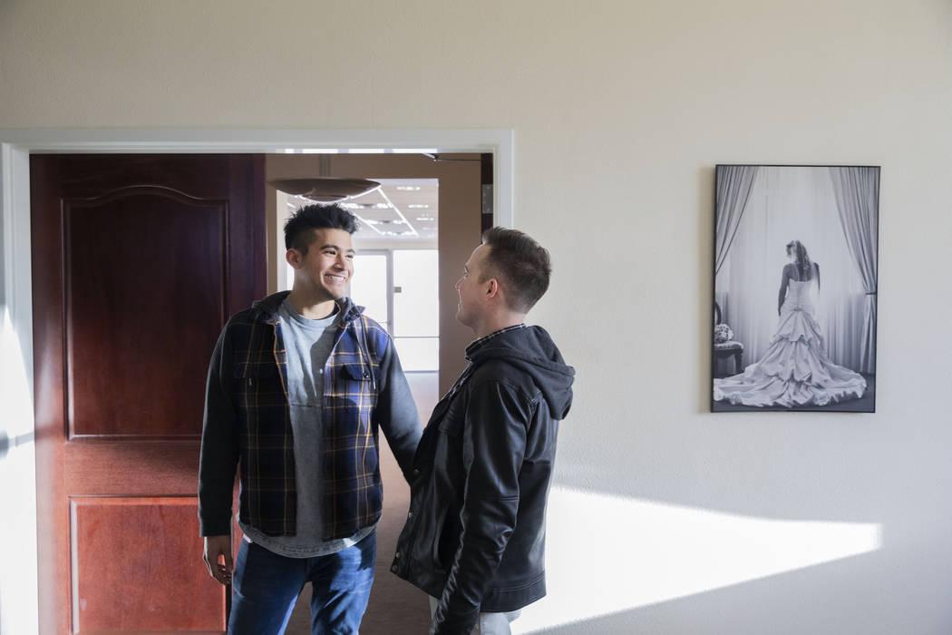 Las Vegas locals Sam Cruz, left, and Jeff Gaglione look enter the bridal suite of their future ...