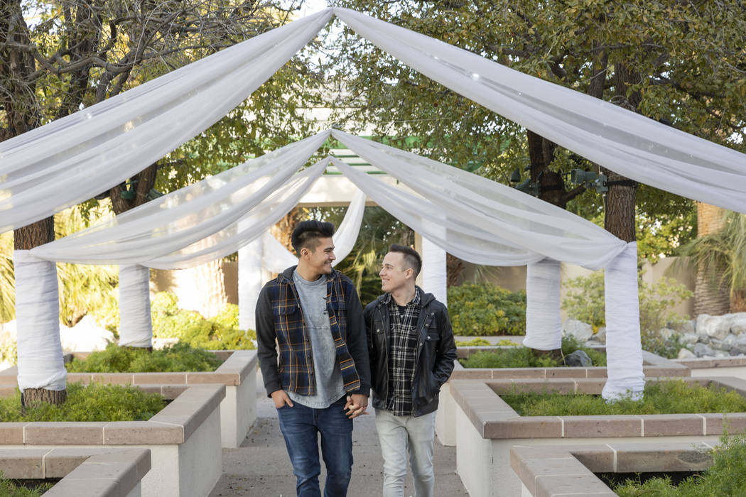 Las Vegas locals Sam Cruz, left, and Jeff Gaglione walk down the aisle together in their future ...