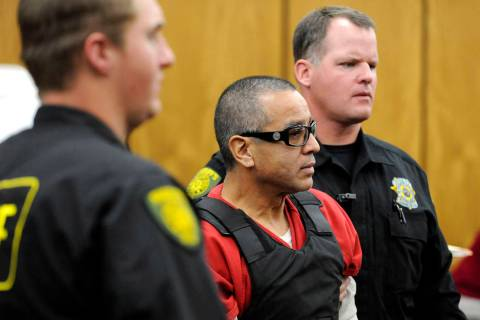 In this Nov. 17, 2011, file photo, Vagos motorcycle gang member Ernesto Gonzalez is led from di ...