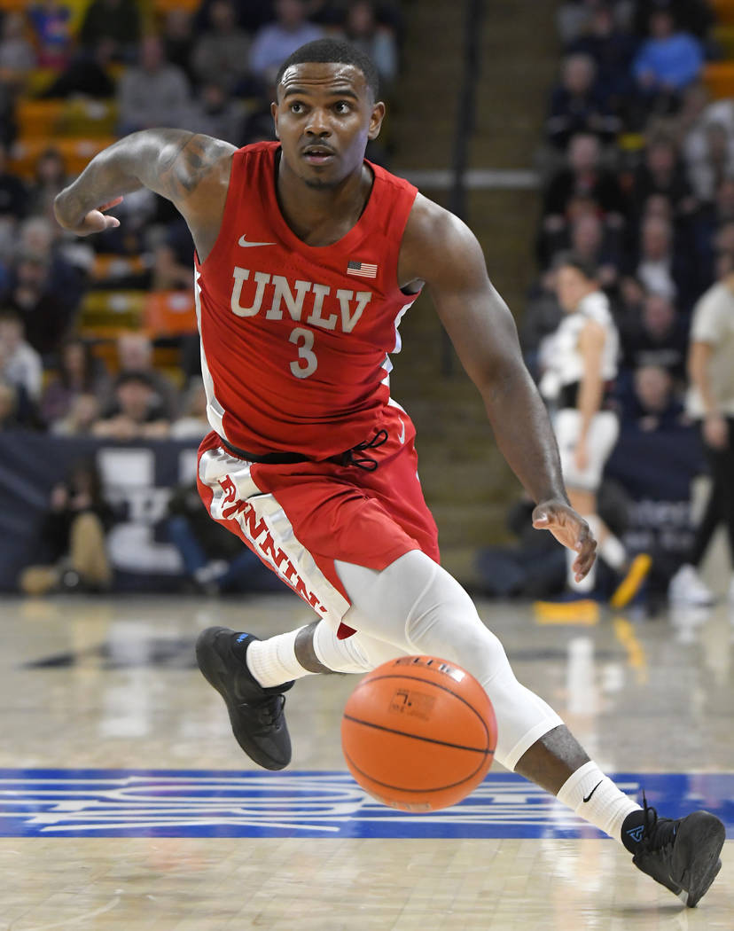 UNLV guard Amauri Hardy runs down a loose ball during the first half of the team's NCAA college ...