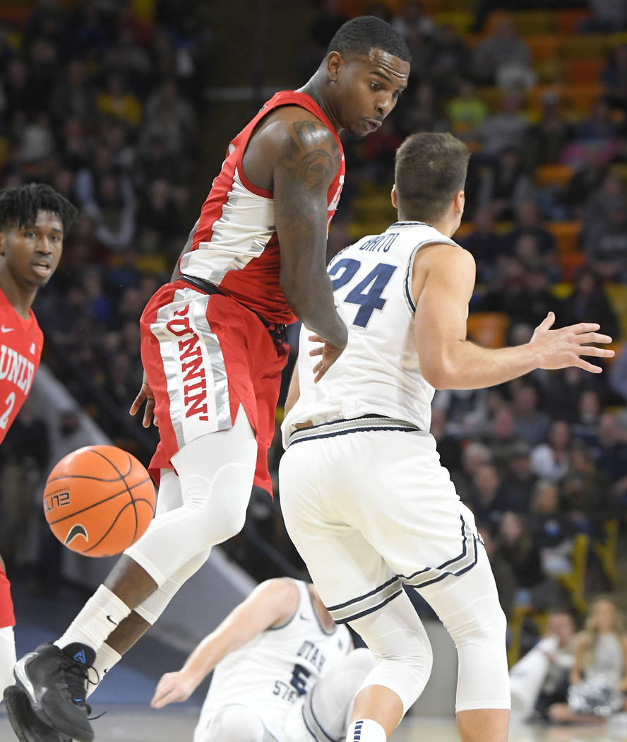 UNLV guard Amauri Hardy, left, goes after a loose ball next to Utah State guard Diogo Brito (24 ...