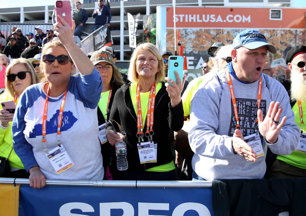 Angela Cummins, left, Jeffery Becker and Miller McKee, right, cheer during the 2020 Spec Mix Br ...