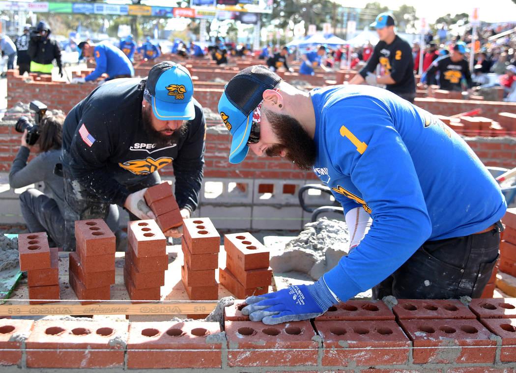 Mario Alves, right, and his tender Michael Alves, both of Ontario, Canada, participates in the ...