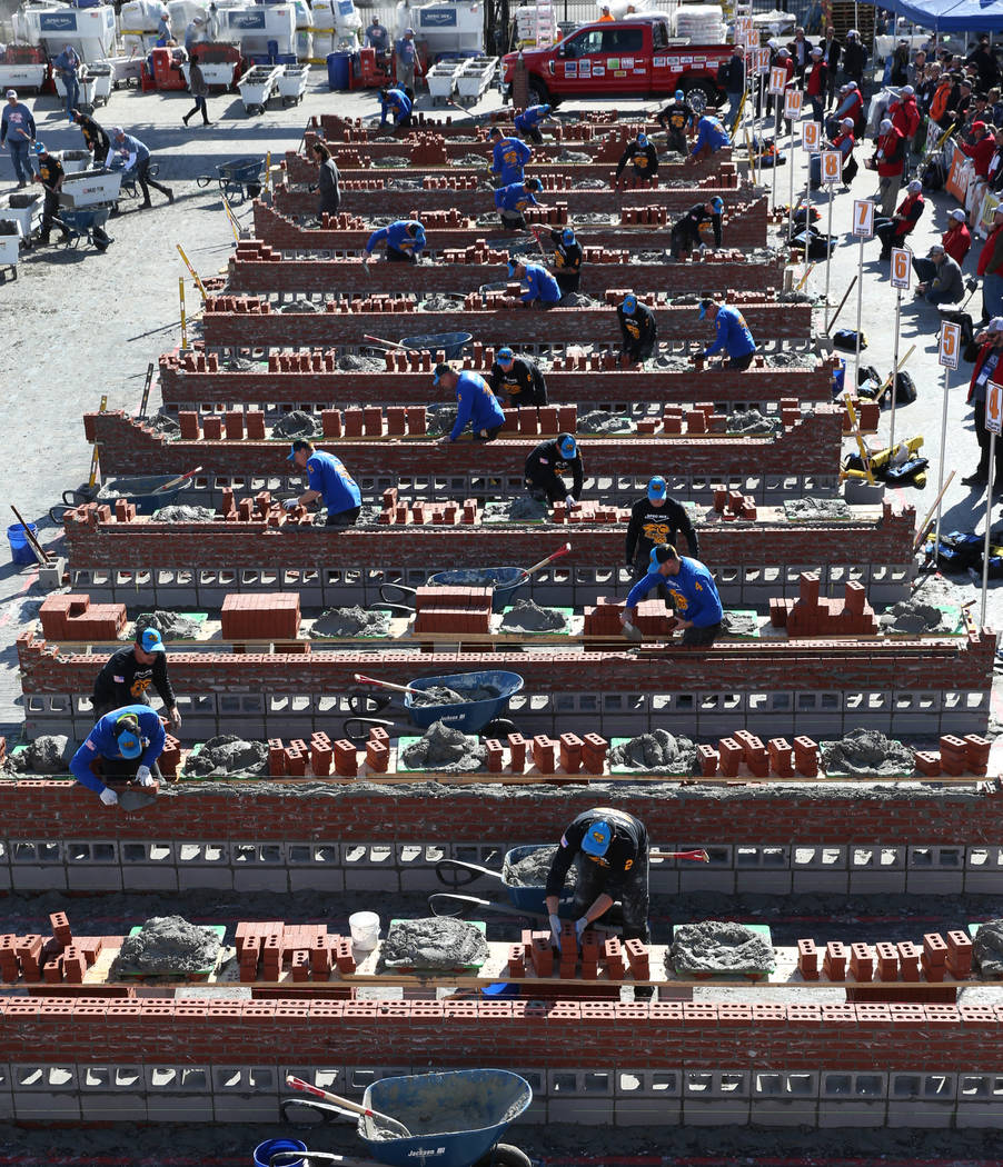 Competitors compete in the 2020 Spec Mix Bricklayer 500 during the World of Concrete on Wednesd ...
