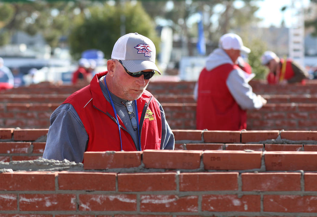 Judges, including Jake Stern of Snohomish, Wash., left, inspect brick walls during the 2020 Spe ...