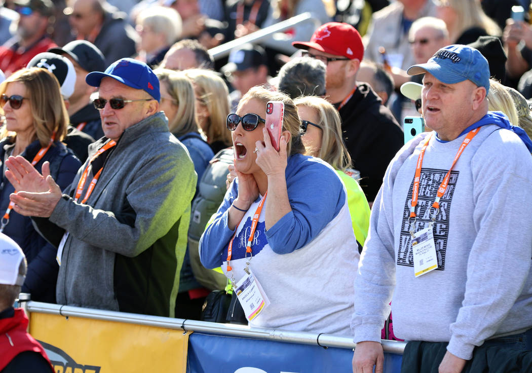 Angela Cummins, center, and Miller McKee, right, cheer during the 2020 Spec Mix Bricklayer 500 ...