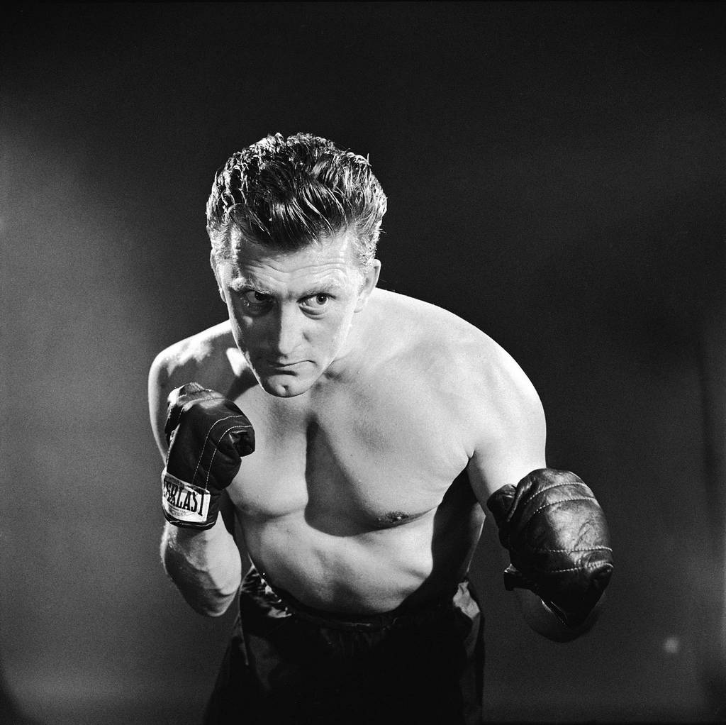 """Kirk Douglas' first leading film role was """"Champion"""" (1949), which made him a respected movie star."""