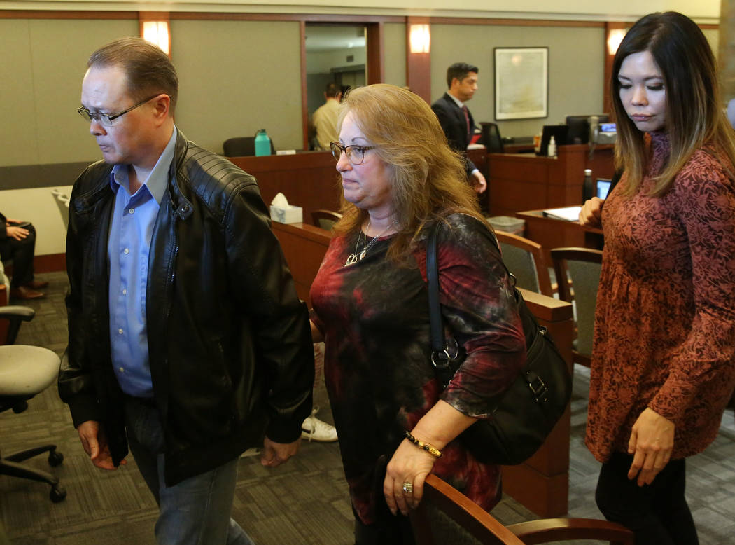 Theresa Christensen, center, mother of Lee's Liquor robbery victim Matthew Christensen, 24, and ...
