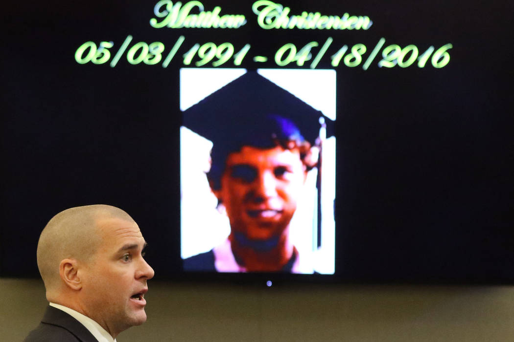 Robbery shooting victim Matthew Christensen's photograph is displayed as prosecutor John Giorda ...