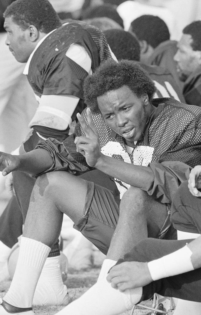 Oakland Raiders quarterback Lester Hayes is shown holding up the victory sign during practice ...