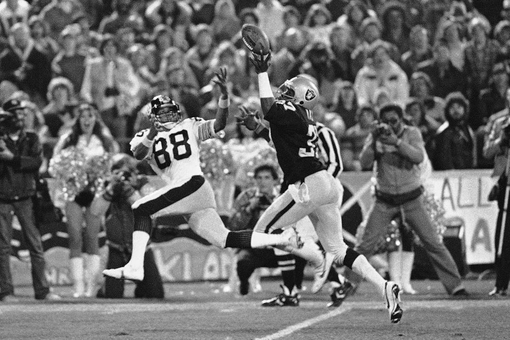 Oakland Raiders back Lester Hayes deflects a pass intended for Pittsburg Steelers wide receiver ...