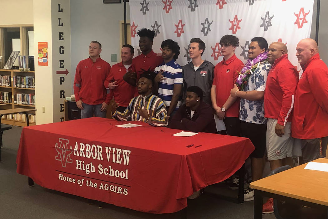 Arbor View football players sign their letter of intent on national signing day on Wednesday, F ...
