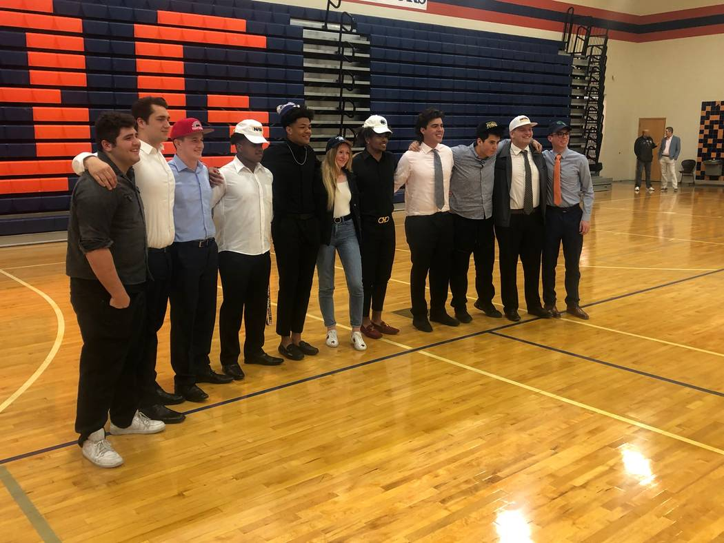 Bishop Gorman athletes pose for a photo after signing their letters of intent on national signi ...