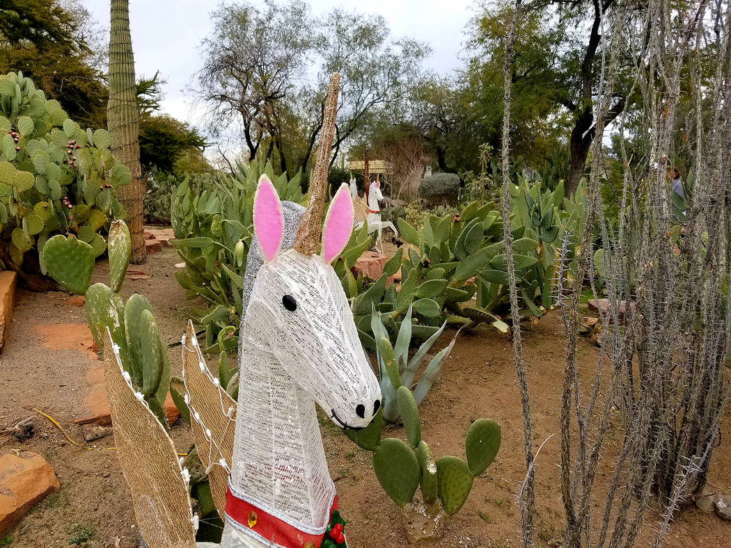 A glittering unicorn decoration mixes with the 300 cactus and desert plant species in Ethel M's ...