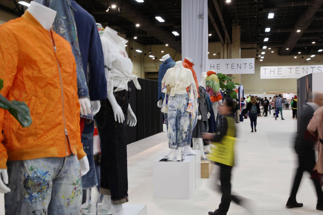 Attendees walk through the dual-gender contemporary Denim Room at Project during the opening mo ...